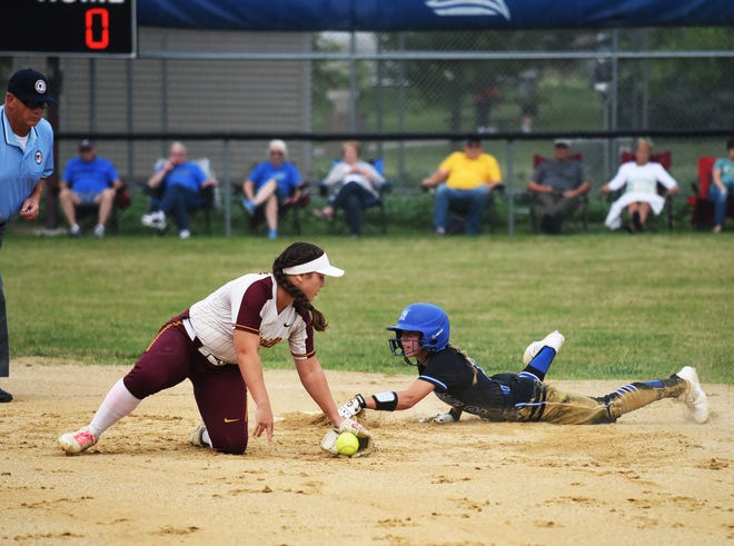 Collins-Maxwell's Alexis Houge easily slides by the tag attempt from Clarksville shortstop Cheyannne Berends as she steals second base during the second inning of the Spartans' Class 1A regional final softball game against the Indians Monday in Collins. Houge was 2-for-2 with a walk, two steals and two runs, but the Spartans fell by a 3-2 score to miss state for the first time in their four years as a program.