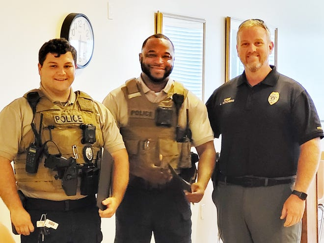 Police Chief Jamey Kitchens recognizes Officers Joseph McAlpin, Harris Jenkins and Corporal P.J. Hambrick (not pictured) for going beyond the call of duty in serving their community.