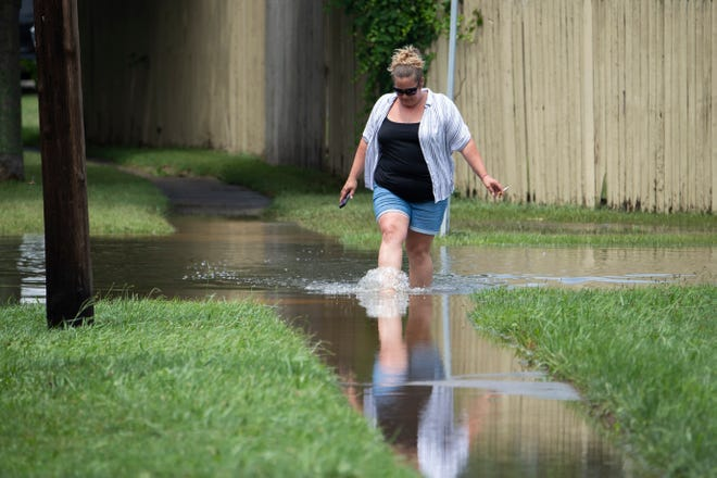 The streets of Croydon, Pa, are still flooded on Tuesday, July 13, 2021, following severe flooding in the area.