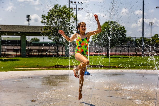 Carlee Harris beats the heat at the new Johnstone Park Splash Pad on Tuesday. The splash pad is located just north of the Johnstone Pavilion, at Hensley Boulevard and Cherokee Avenue.