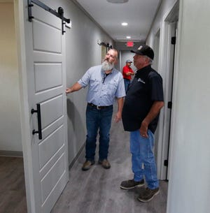 Henry Wied (left), City of Brownwood director of public works, and city councilman H.D. Jones stand in the hallway of the new Fire Station 2 addition Tuesday.