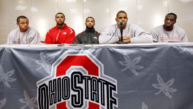Ohio State football players, from left, DeVier Posey, Mike Adams, Boom Herron, Terrelle Pryor and Solomon Thomas address members of the media during a news conference Tuesday, Dec. 28, 2010, at the Woody Hayes Athletic Center in Columbus, Ohio. Ohio The Buckeye players were suspended by the NCAA for the first five games of the 2011 season for selling championship rings, jerseys and awards, and receiving improper benefits from a tattoo parlor.