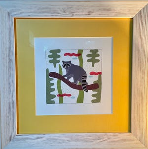 A whimsical raccoon drawing the writer purchased from an artist at a European market a few years ago, and which lately feels less whimsical and more mocking.