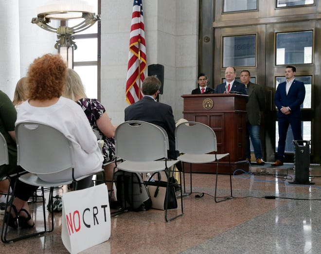 Opponents of the teaching of critical race theory, including Mark Pukita, an Ohio Republican candidate for U.S. Senate, gathered at the Ohio Statehouse on  Tuesday.