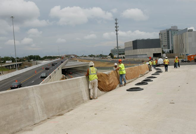 Kokosing Construction and Ohio Department of Transportation employees work Tuesday to prepare the Fulton Street entrance ramp from Downtown to Interstate 70 eastbound for planned reopening Friday or Saturday.