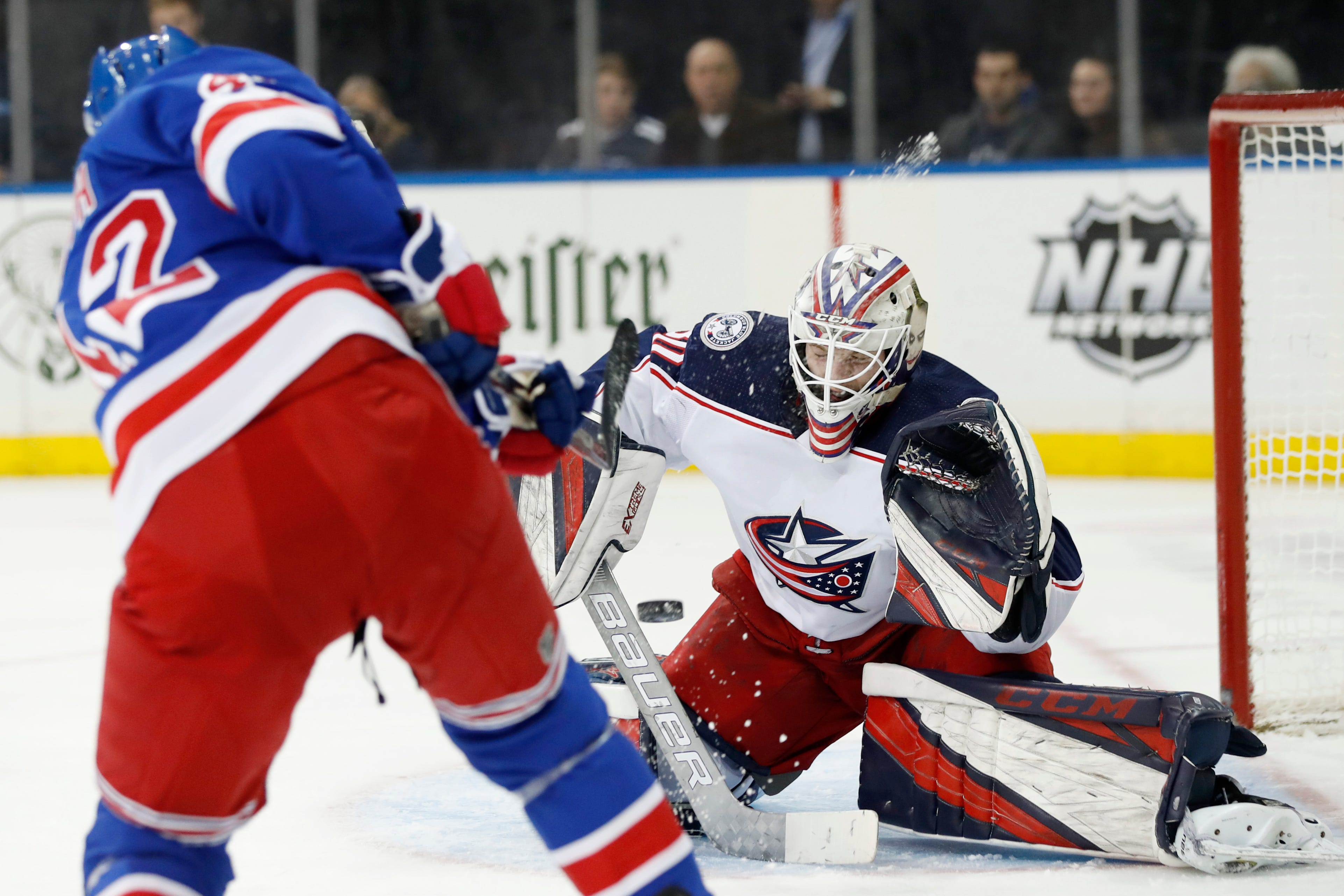 Rangers defenseman Brendan Smith shoots as Blue Jackets goalie Matiss Kivlenieks reacts during the second period of an NHL hockey game, Sunday, Jan. 19, 2020, in New York.