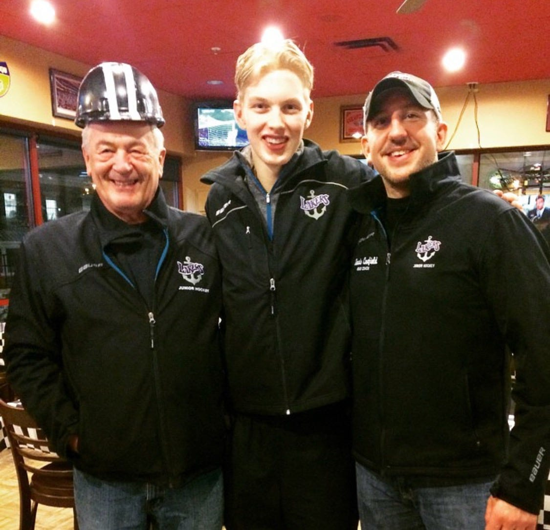 Dennis Canfield, right, and his father, Dennis Canfield Sr., pose with Matiss Kivlenieks after a game in 2015 with the Forest Lake Lakers of the former Minnesota Junior Hockey League.