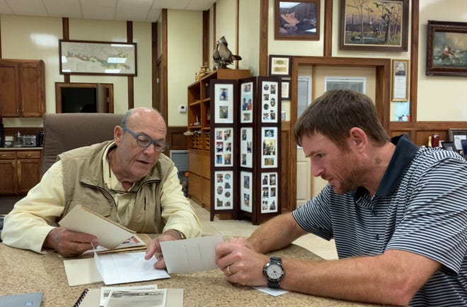 Author Jason Theriot (right) worked with company President Benny Cenac (left) to write a book about Cenac Towing Co. of Houma and its history and contributions to south Louisiana.