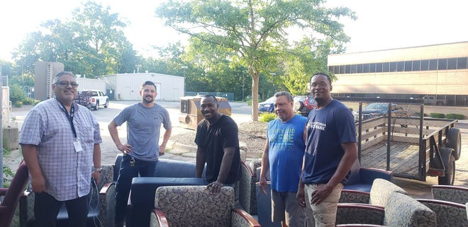 From left, Rudy Flores, Southeastern Michigan Migrant Resource Council chairperson; Frank Nagle, director of community impact in Michigan for ProMedica; Chris Carter of the All About Adrian (A3) resident coalition; Teddy White, of the NAACP; and De'Angelo Boone of City of Refuge Ministires and A3 are pictured with some of the furniture donated by ProMedica to migrant farm workers in Lenawee and Monroe counties.