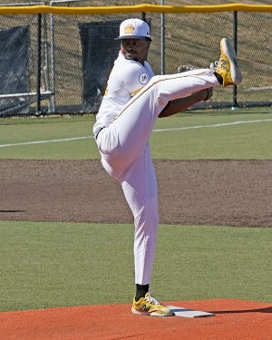 Adrian College pitcher Mo Hanley winds up for a pitch during a game in the 2021 season.