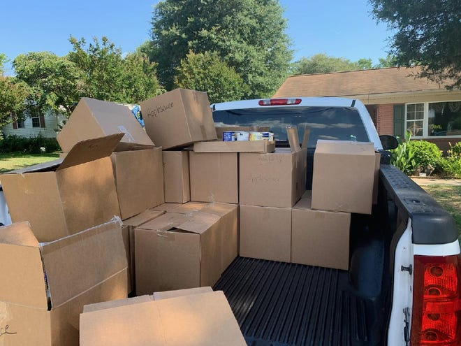 Pictured are some of the cases of non-perishable food items that will be given away beginning at 10 a.m. Saturday at Coggins Memorial Baptist Church as part of a Love Token outreach ministry.