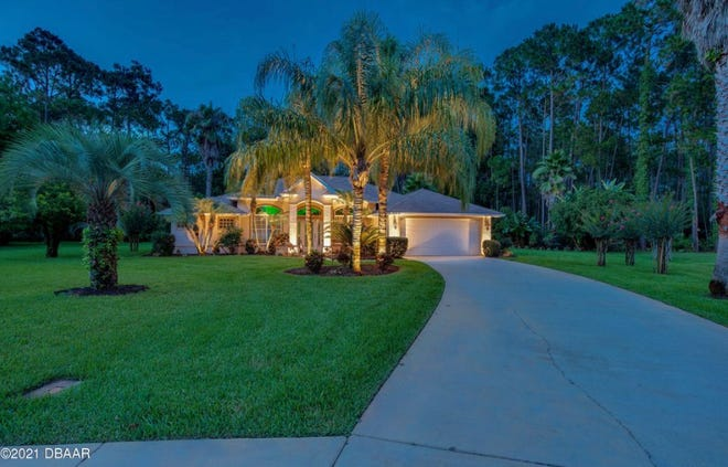 This Ormond Beach pool home is beautifully situated on a large, very private, tree-lined lot on a quiet cul-de-sac.
