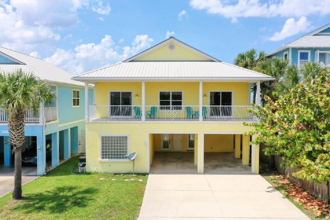 This multi-family home, with two separate units, is just steps to the beach and the Flagler Pier.