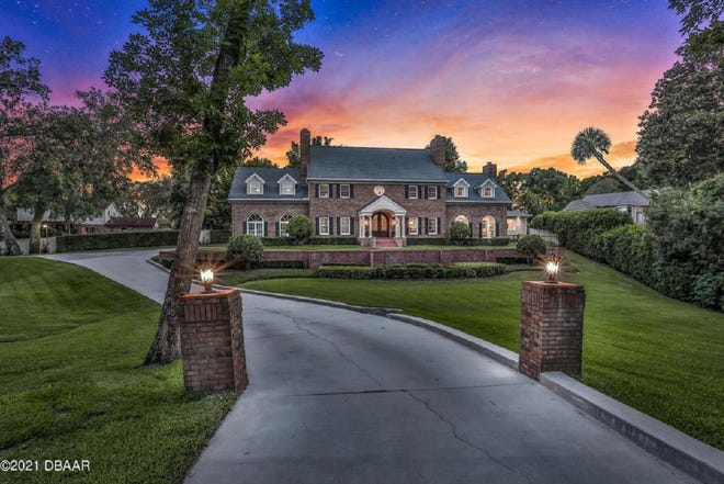 This stunning Colonial-style estate sits on over an acre, nestled back on a cul-de-sac of Ormond Beach's beautiful Tidewater neighborhood.