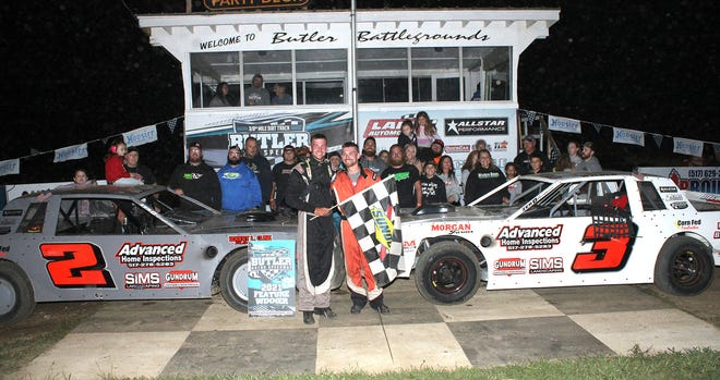Kaleb Wilber (2) won Saturday night's street stock feature followed by his brother, Jake (3). Here the Wilbers celebrate in victory lane with their family.
