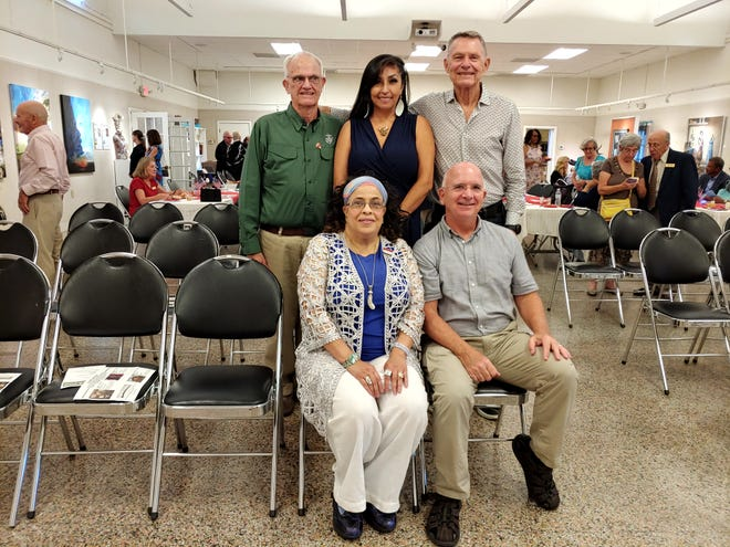 Veteran artists Phyllis Miller and Father Ron Camarda (seated), along with Cliff Leonard, Maria Mia Salazar and Jerome Domask (standing) attended the pre-opening celebration of the Then & Now exhibit, where their art is on display at the St. Augustine Art Association now through Aug. 22.