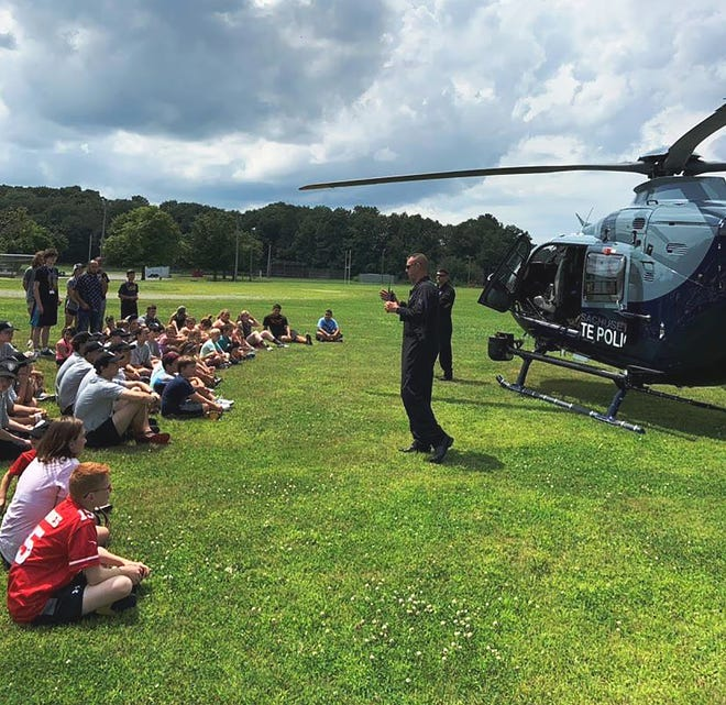 Sgt. Eric Fairchild of the Massachusetts State Police conducts a demonstration of the department's Air Wing helicopter at Gardner Middle School during the Gardner Police Department's first-ever Junior Police Academy in 2019.