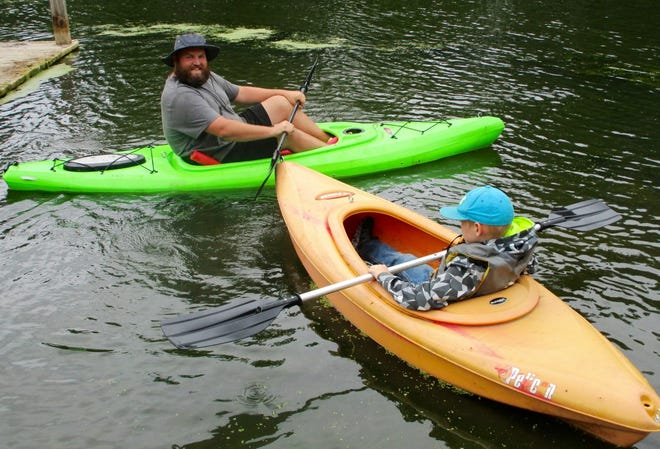 """Tim Eastman and his son were part of the """"Try-A-Kayak"""" event sponsored by Foster Hope."""