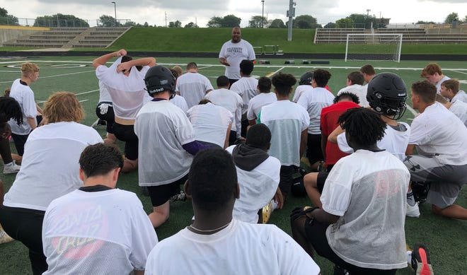Galesburg High School football coach Derrek Blackwell talks to those attending the Silver Streaks' team camp after Tuesday morning's speed school and OTA session.