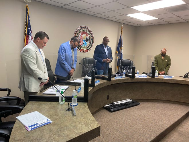 Donaldsonville City Council members stand at the beginning of the July 13 meeting. Shown from left are: Michael Sullivan, Reginald Francis Sr., Charles Brown Sr., and Lauthaught Delaney Sr.