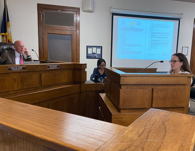 Grayson County Health Department Director Amanda Ortez stands at the podium in front of commissioners Tuesday as they agree to accept additional COVID-19 relief funds