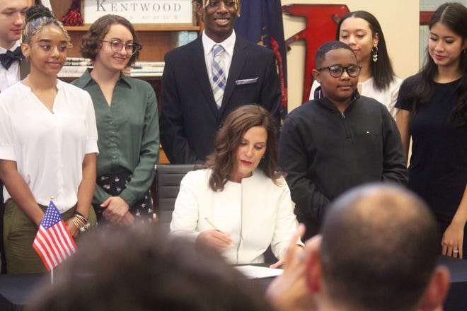 Michigan Gov. Gretchen Whitmer signs a $17.1 billion school aid budget for the 2021-22 fiscal year at East Kentwood High School on Tuesday, July 13, 2021, in Kentwood, Mich.
