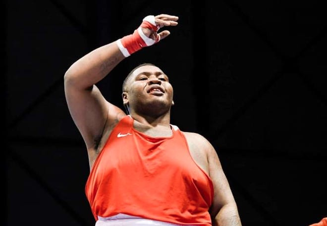 Joseph Sirobbie Nelson reacts after winning the Michigan Golden Gloves championship on Saturday at the DeltaPlex in Grand Rapids.