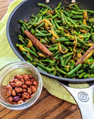 Sri Lankan Green Bean Coconut Curry is made with cinnamon, coconut milk and a variety of green beans.