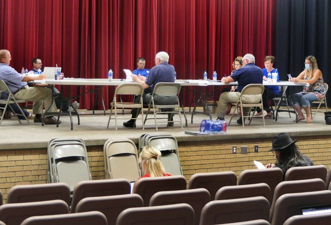 Pretty Prairie's Board of Education meets on the stage of Pretty Prairie Middle School on July 12, 2021.