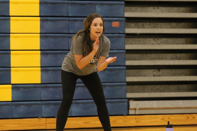 Nickerson head volleyball coach Payton Scheer encourages her team at the team's camp at Nickerson High School on Monday, July 12, 2021.