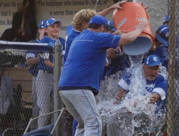 Ripley Middle School head baseball coach Duke Gandee gets a ceremonial ice water bath as the team finishes out a perfect season at 14-0.