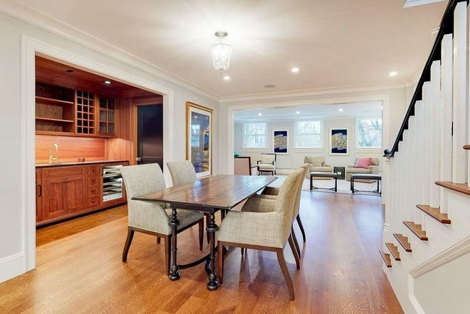 The central dining room separates front living-room entertaining from rear kitchen cooking while flowing into each area for both guest and host convenience. Also convenient is the adjacent mahogany wet bar.