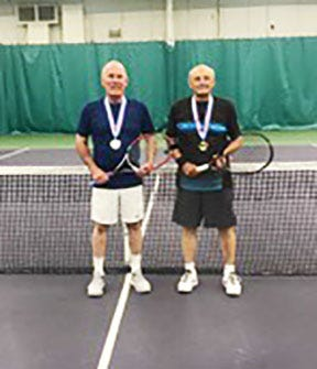 Jim Doyel, left, and Larry Nave win men's tennis doubles championship at Tennessee Senior Olympics.