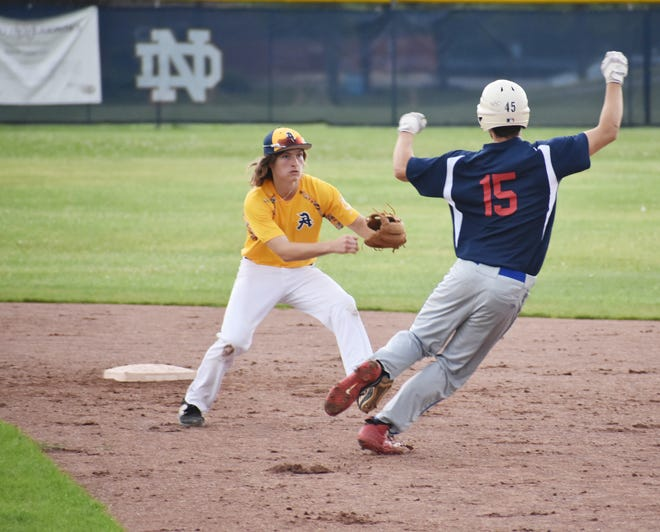 Adrean Post's Isaiah Zuchowski tags out New Hartford Post's Devin Snyder during a Legion District V Legion baseball game Tuesday, July 13, 2021 at Notre Dame High School. Adrean Post topped New Hartford 4-3. New Hartford Post was eliminated from the tournament.