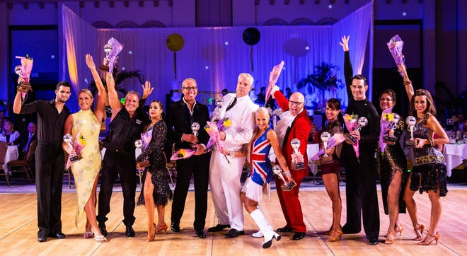 Ballroom Battle dancers pose with Mirror Ball trophies at a past George Snow Scholarship Fund Ballroom Battle.