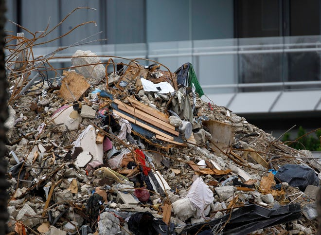 Personal belongings are mixed in with the remains of the Champlain Towers South condo in Surfside, Florida Monday, July 12, 2021. Some people have suggested that a 2008 law requiring five-year safety inspections of condos might have averted tragedy, but was repealed in 2010.