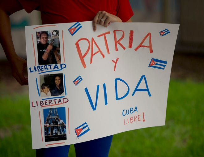 Dozens of people gather at Jose Marti Park in West Palm Beach July 13, 2021 to show support of Cuban citizens.