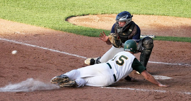 Hendricken's Caleb Wurster beats the throw to catcher Liam McGill and is safe at home during a game against South Kingstown in 2016. Wurster, who went on to play at UConn,  was drafted by the Miami Marlins on Tuesday. McGill, who played for Bryant this past season, was also drafted — by the Atlanta Braves.