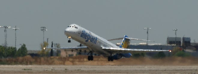 Heat waves comes off the runway as the Allegiant flight to Las Vegas on June 16, 2006.