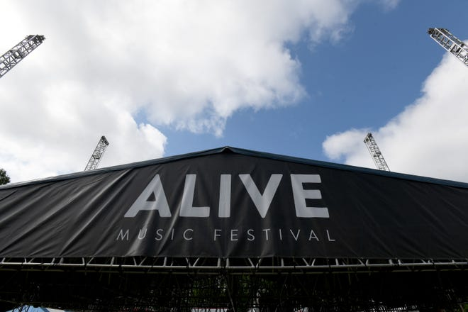A stage is erected Tuesday at Atwood Lake Park for the Alive Music Festival. The event is Thursday through Sunday. Last year's festival was canceled due to the COVID-19 pandemic, but this year's event is expected to draw people from all 50 states.