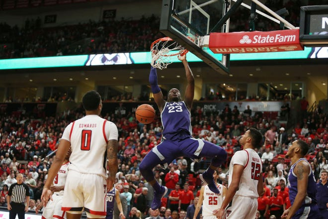 Kansas State Wildcats forward Montavious Murphy (23) hangs on the rim in the second half against the Texas Tech Red Raiders on Feb. 19, 2020, at United Supermarkets Arena.