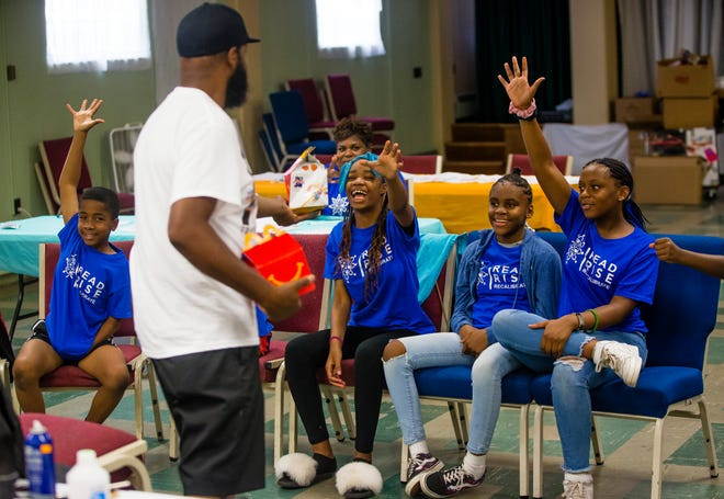 Kentae Lark talks to Read, Rise and Recalibrate students about entrepreneurship during a session Tuesday, July 13, 2021 at Kingdom Life Christian Cathedral in South Bend.