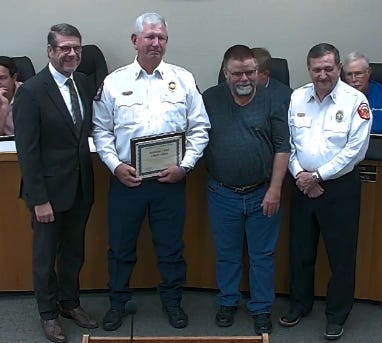 Stephenville Assistant Fire Chief Chuck Elliott, second from left, is presented a certificate of appreciation for his work at the Erath County Vaccination Center from the city by City Manager Allen Barnes, left; Mayor Doug Svien, second from right; and Fire Chief Jimmy Chew during last week's city council meeting.