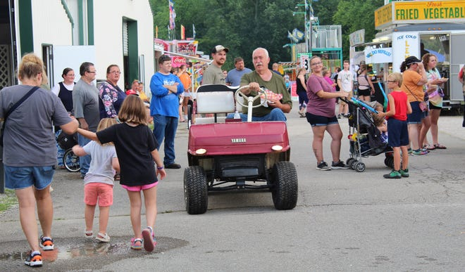 Long time Owen County Fair Association board member Bill Pursell makes his way around the grounds while picking up a snack from one of the many food vendors during fair week. Many more photos from the 2021 Owen County Fair will be featured in upcoming publications of the Spencer Evening World.