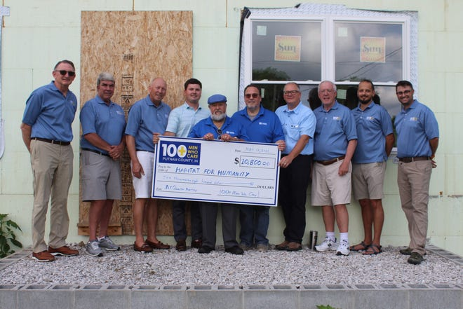 From left, Todd Lewis, Page Cotton, Mike Harmless-100+ Men of PC; Jake Widner, David English, Scott Dunbar and Chris Skillern-Habitat for Humanity; David Murray, Vince Aguirre, Camron Humphreys-100+ Men of PC all pose with the grant donation check.