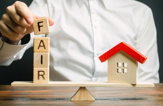 It is difficult to assess property value potentially undergoing a zoning change.