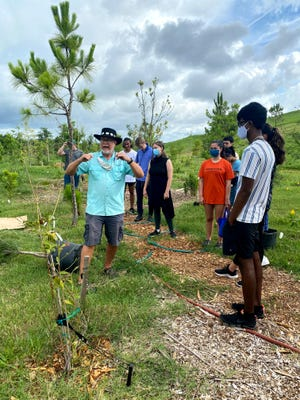The community microforest project at Nathan Benderson Park will continue through the summer. A volunteer event is scheduled for Saturday.