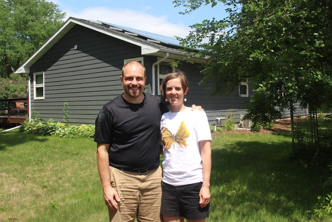 David and Carissa Lick are one of the first people to install solar panels for their home in St. James.