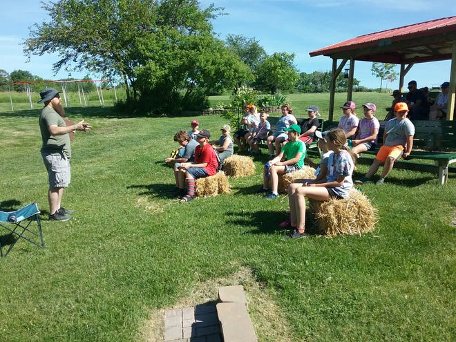 Pastor Andrew Christman presents a devotional message at Neponset's recent Christian Day Camp.