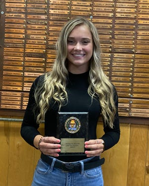 Chloe Gruzceska shows off the plaque she earned for winning the Illinois VFW Auxiliary's annual patriotic art contest. She is the second state winner from Kewanee.